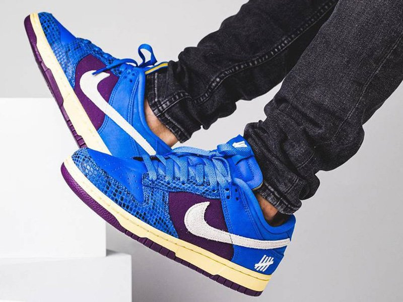 Undefeated x Nike Dunk Low In Blue and Purple On Feet